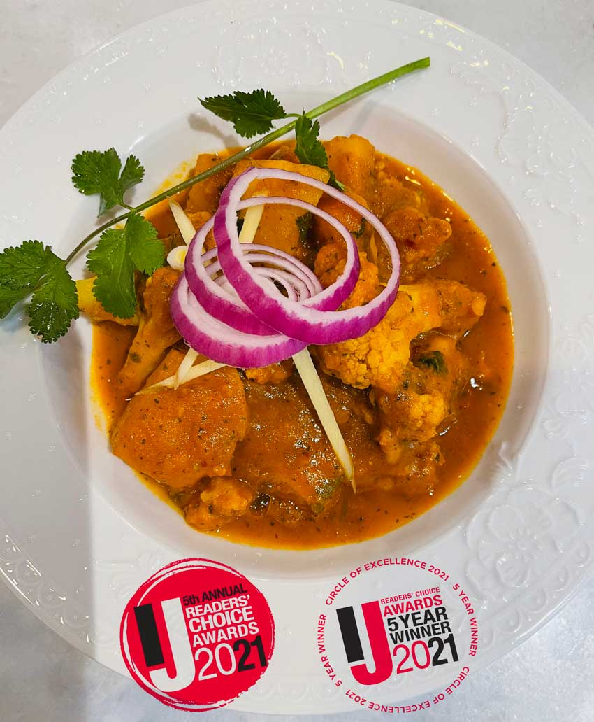 Lotus Cuisine of India - Best Indian Restaurant in Marin and 5-Year Winner Circle of Excellence - A plate of Aloo Gobi and Marin IJ Readers' Choice Awards Badges